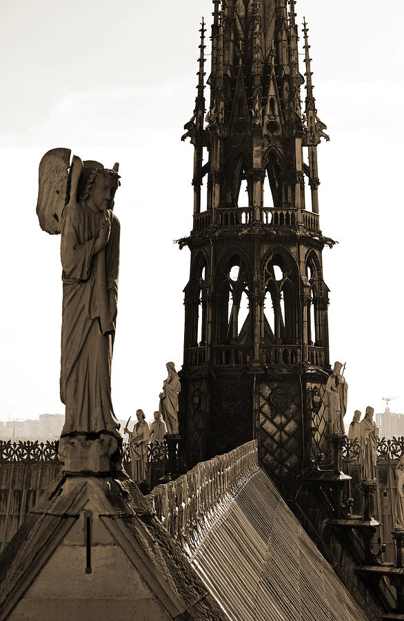 Angel Atop Notre Dame De Paris Cathedral With Gothic Steeple Background Sepia