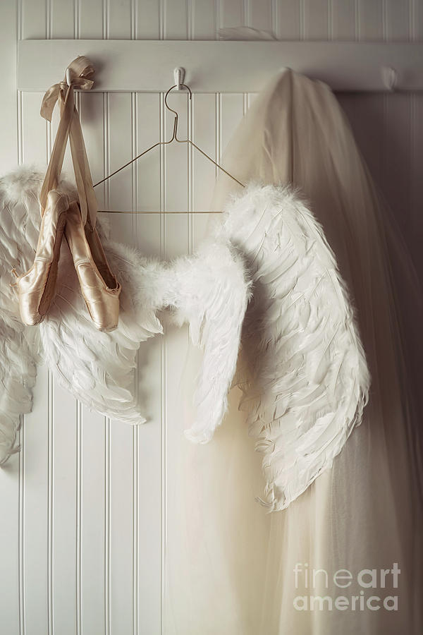 Angel wings and ballet shoes hanging on hooks                    by Sandra Cunningham