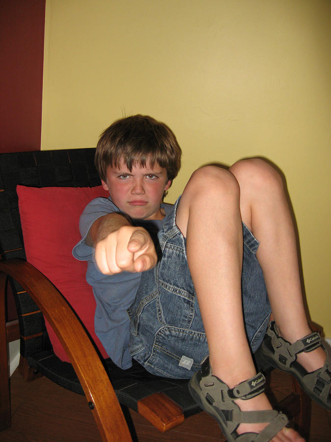 Vertical Photograph - Angry Boy Pointing The Accusing Finger by Christopher Purcell