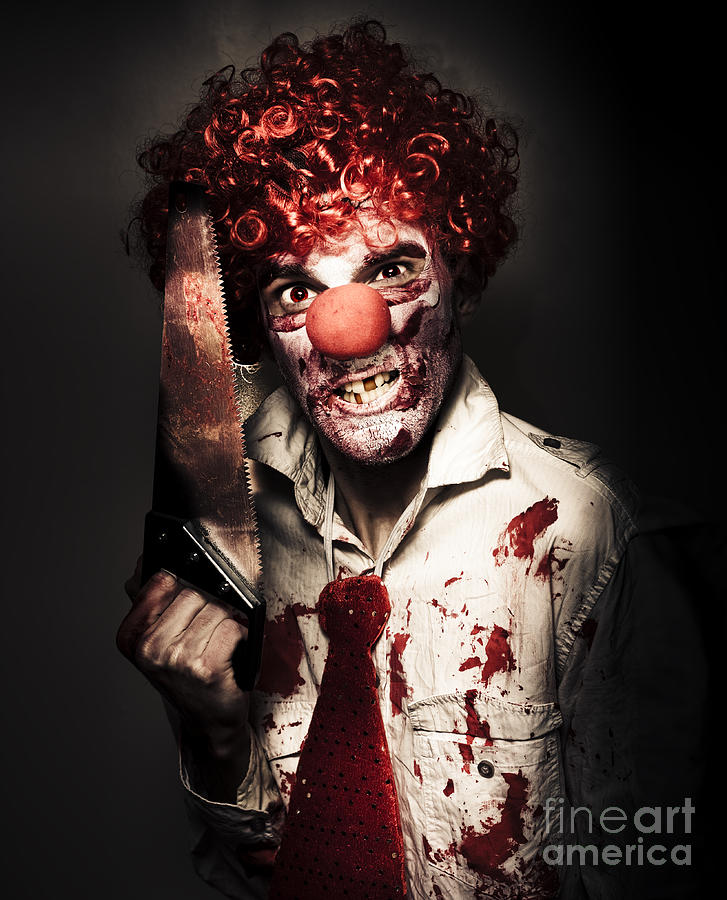 Amputation Photograph - Angry Horror Clown Holding Butcher Saw In Darkness by Jorgo Photography - Wall Art Gallery