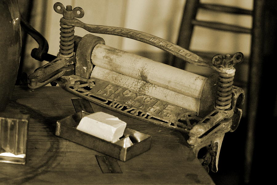 Sepia Photograph - Antique Laundry Ringer and Handmade Lye Soap in Sepia by Colleen Cornelius