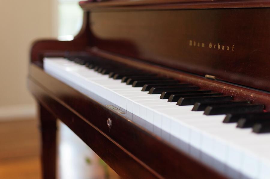 Music Photograph - Antique Piano by Bradley Hebdon
