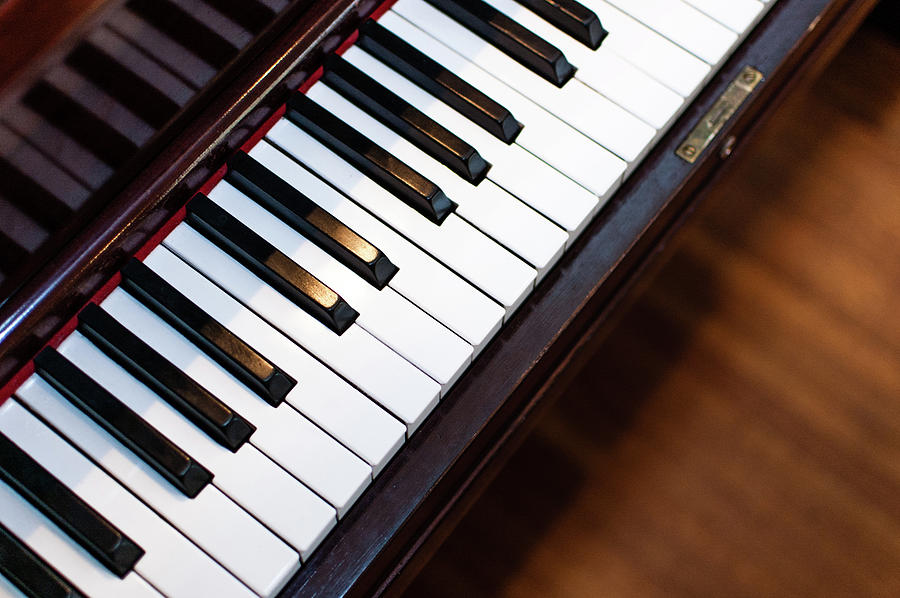 Piano Key Photograph - Antique Piano Keys From Above With Hardwood Floor by Bradley Hebdon