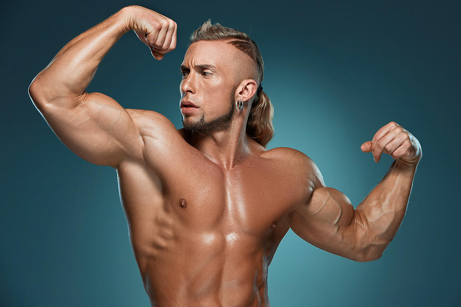 3df7235948d Attractive Male Body Builder On Blue Background Photograph by ...