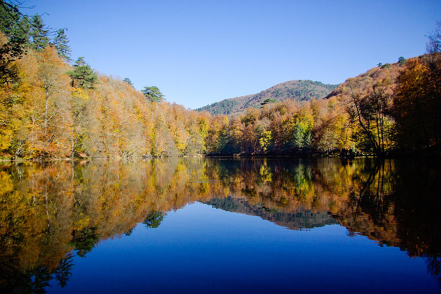 Autumn Photograph - Autumn colors of the forest reflected on the pond, Yedigoller, Bolu, Turkey by Freepassenger By Ozzy CG