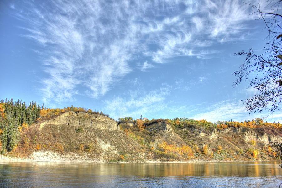 Autumn sky on the river by Jim Sauchyn