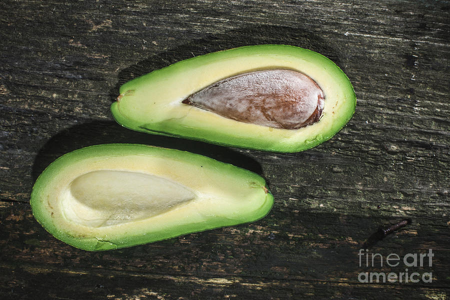 Avocado Photograph - Avocado On Wood by Deyan Georgiev