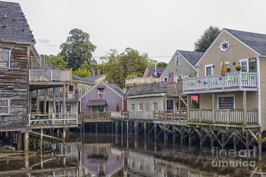 Backside Of Wooden Houses Over Water Photograph