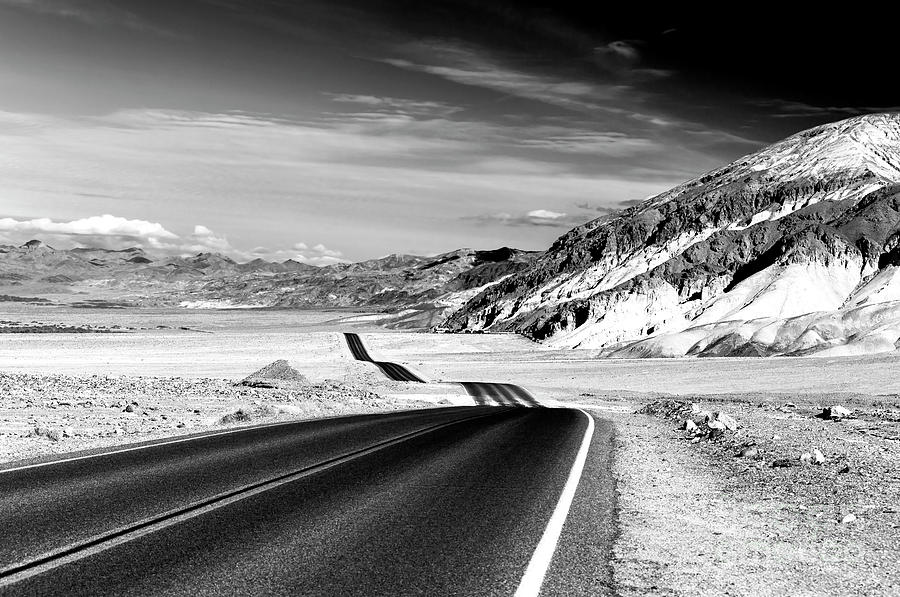 Badwater Road Photograph - Badwater Road In Death Valley by John Rizzuto