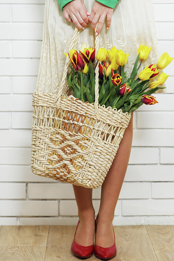 Yellow Tulips Photograph - Bag With A Bouquet Of Tulips by Iuliia Malivanchuk