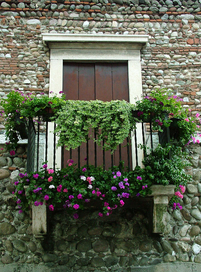 Italy Photograph - Balcony On Pebbled Wall by Donna Corless