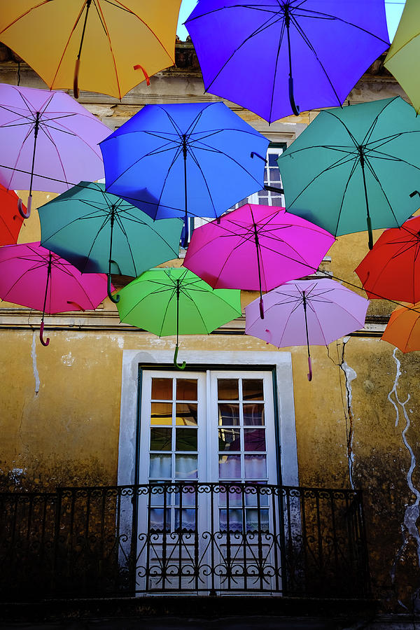 Floating Umbrellas Photograph - Balcony With A View by Marco Oliveira