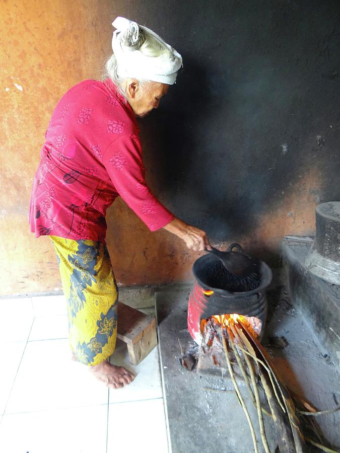 Unschooling Photograph - Balinese Lady Roasting Coffee Over The Fire by Exploramum Exploramum