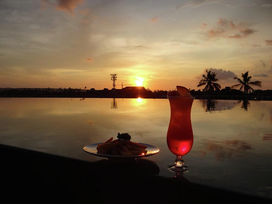 Unschooling Photograph - Balinese orange sunset with drink by Exploramum Exploramum