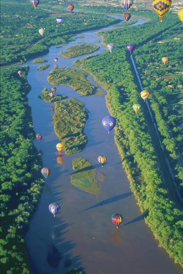 Albuquerque Photograph - Balloons Over The Rio Grande by Alan Toepfer