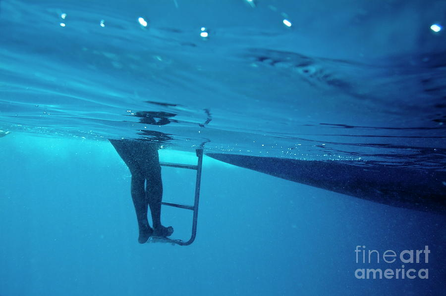 Below Photograph - Bare Legs Descending Underwater From The Ladder Of A Boat by Sami Sarkis