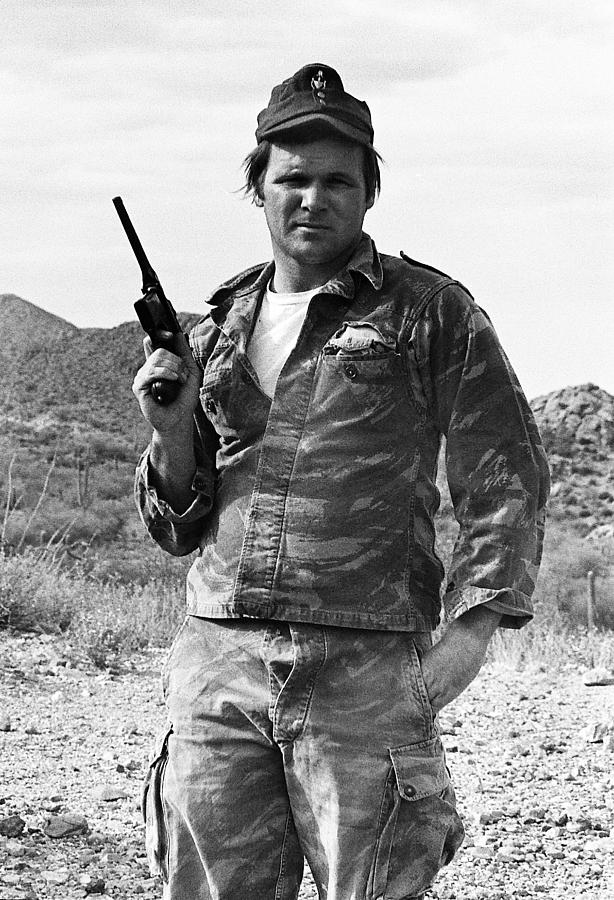 barry sadler holding a one of his favorite pistols tucson