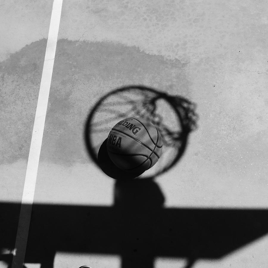 Basketball and hoop shadow basketball and hoop shadow a black and white photograph
