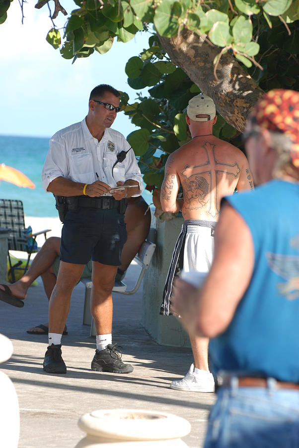 Cops Photograph - Beach Cops And Christ by Rob Hans