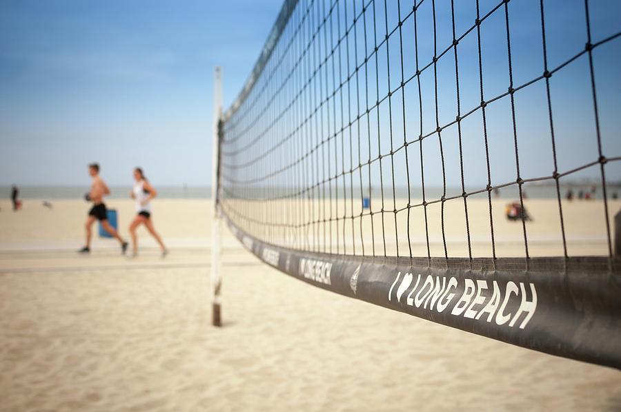 Beach Volleyball Photograph - Beach Volleyball Net On The Sand At Long Beach, Ca by Bradley Hebdon