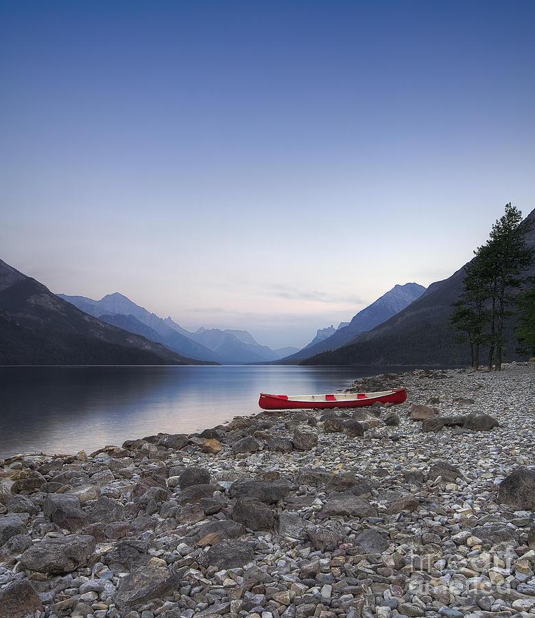 Landscape Photograph - Beached Canoe Awaits Nightfall by Royce Howland