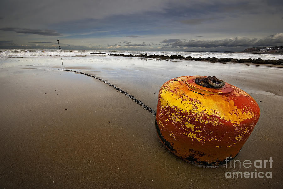 Atmospheric Photograph - Beached Mooring Buoy by Meirion Matthias
