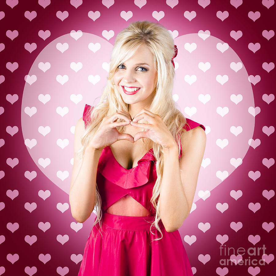 Female Photograph - Beautiful Blonde Woman Gesturing Heart Shape by Jorgo Photography - Wall Art Gallery