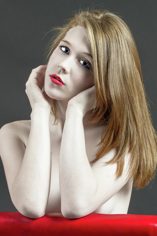 Beautiful White Woman On Red Chair Photograph