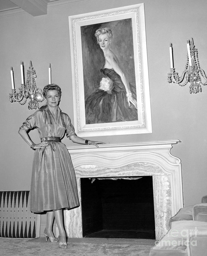 Beauty, Betty Furness, Poses With Her Likeness Behind Her. 1956 Photograph by Anthony Calvacca