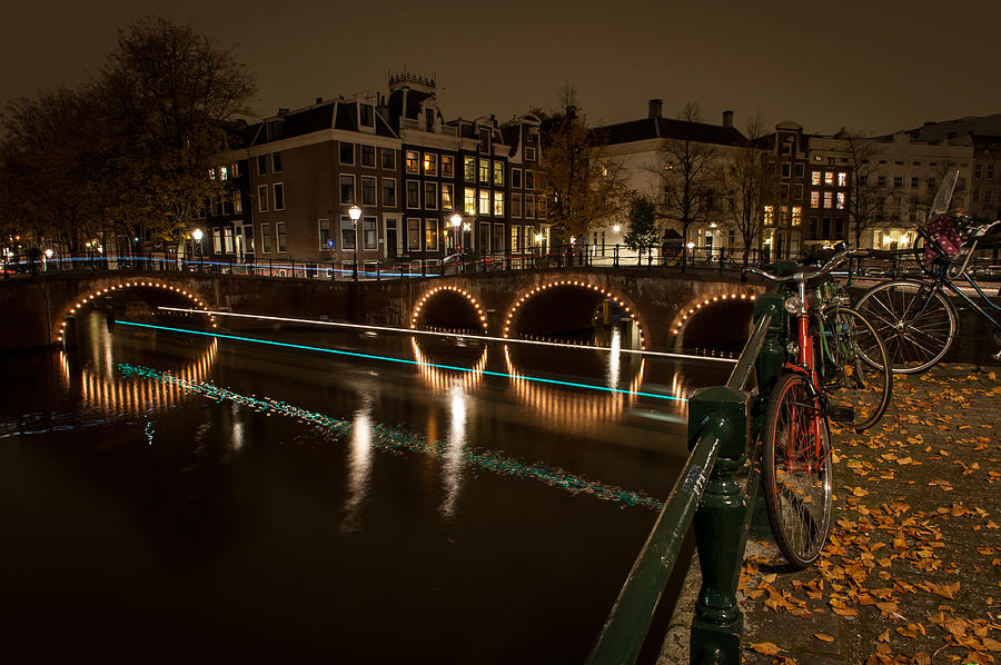 Canals Photograph - Bicycle Parked At The Canals by Wim Slootweg