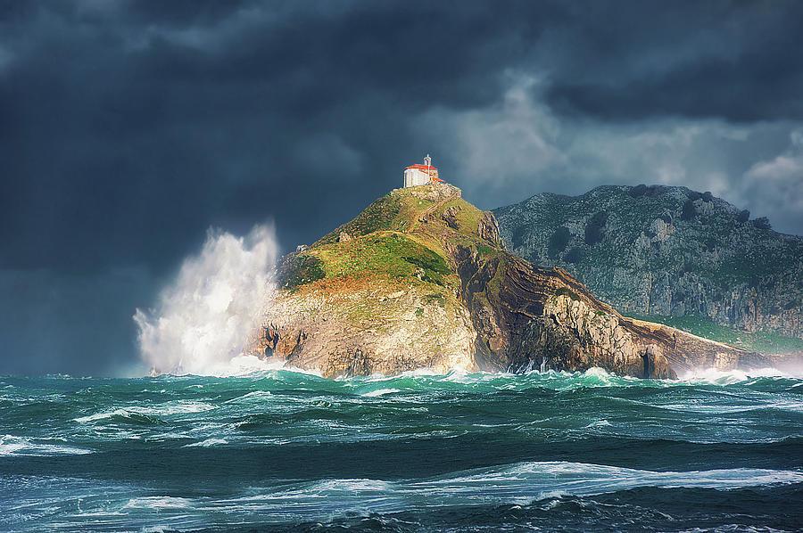 Gaztelugatxe Photograph - Big waves over San juan de gaztelugatxe by Mikel Martinez de Osaba