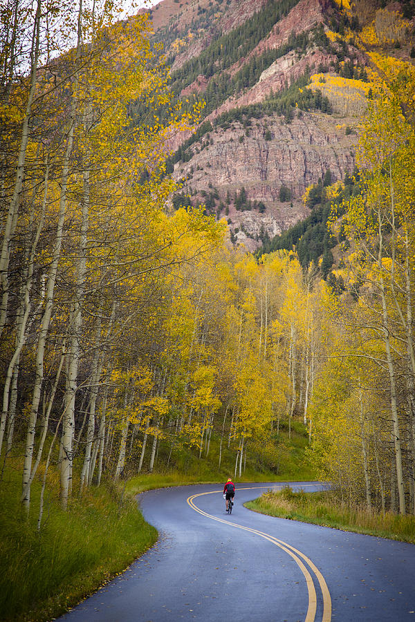 Biking Down Maroon Creek Road by Joe Miller