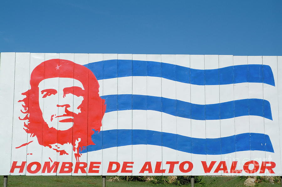 Billboard Photograph - Billboard With The Iconic Che Guevara Portrait And National Cuban Flag by Sami Sarkis