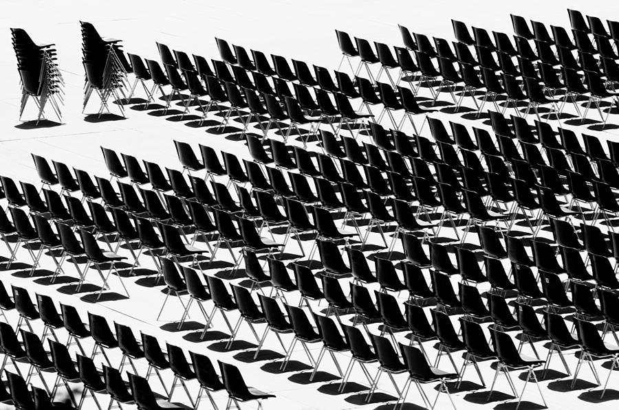 Black and white chairs by Mirko Chessari