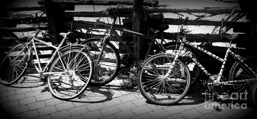Bike Photograph - Black And White Leaning Bikes by Emily Kelley