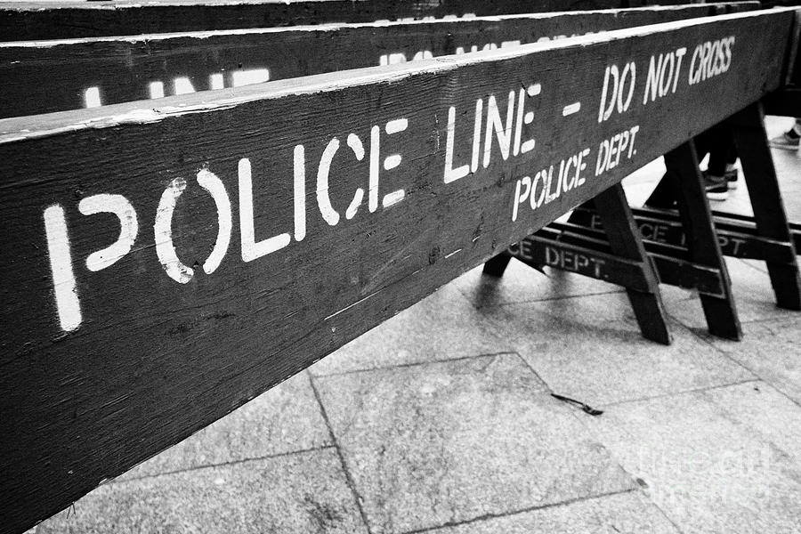 blue wooden police line do not cross nypd crowd traffic barrier New York  City USA