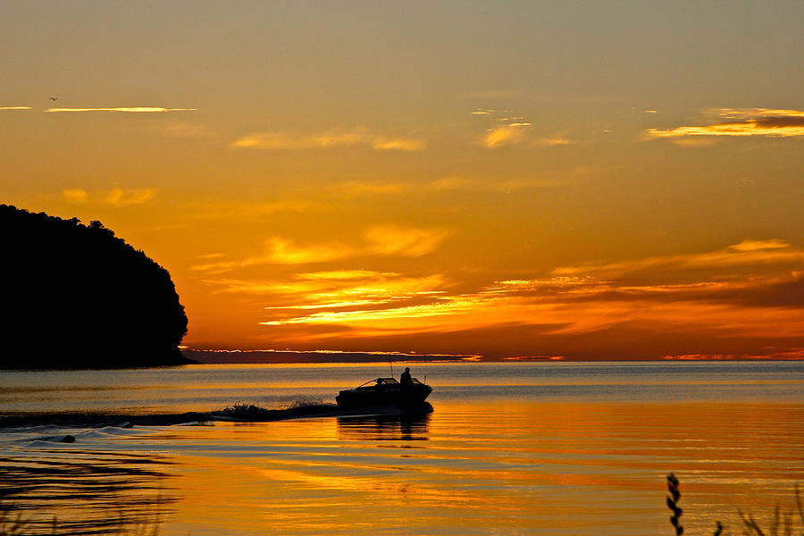 Boat and Bluff at Sunset by Jon Reddin