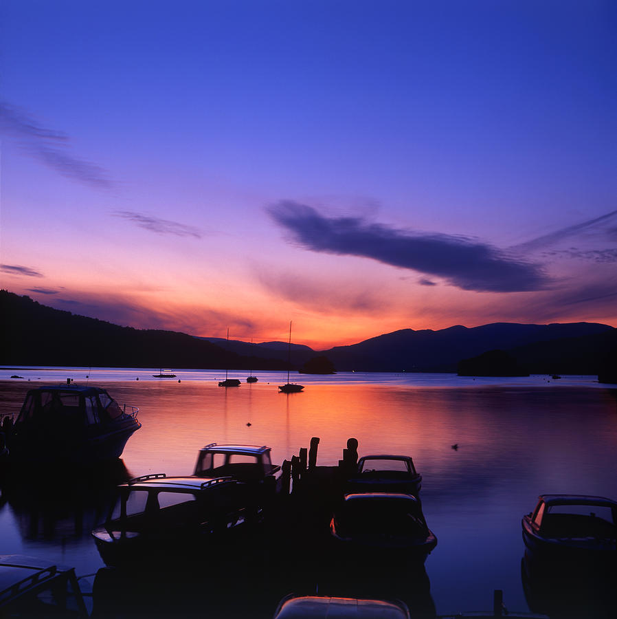 Boat Jetty  at sunset on  Windermere, Cumbria, UK by Maggie McCall