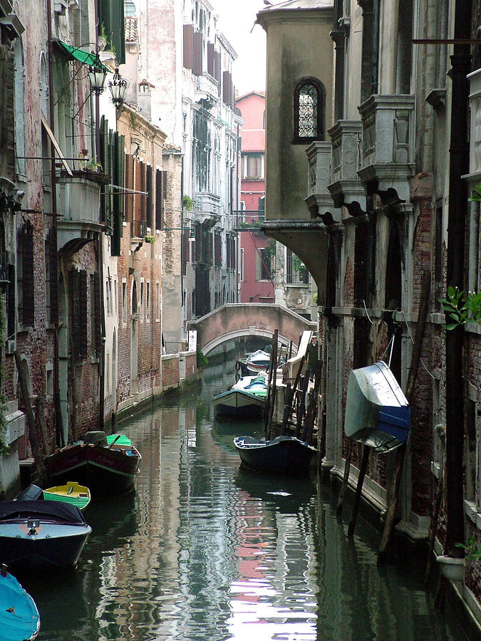 Venice Photograph - Boat On The Wall by Donna Corless
