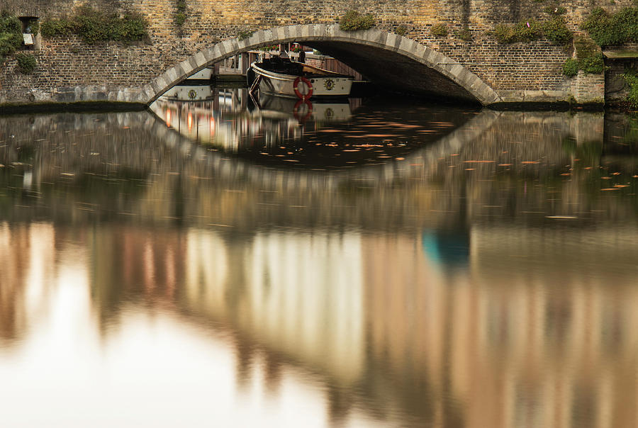 Flanders Photograph - Boat waddling on water channels of Bruges, Belgium by Dalibor Hanzal