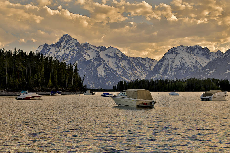 Evening Photograph - Boats On Jackson Lake At Sunset by Dan Sproul