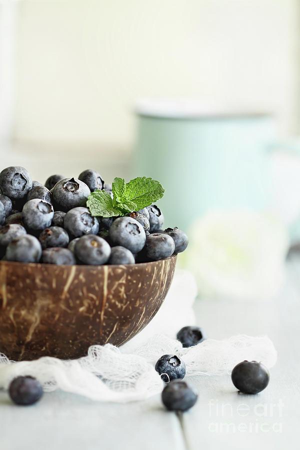 Bowl of fresh blueberries by Stephanie Frey