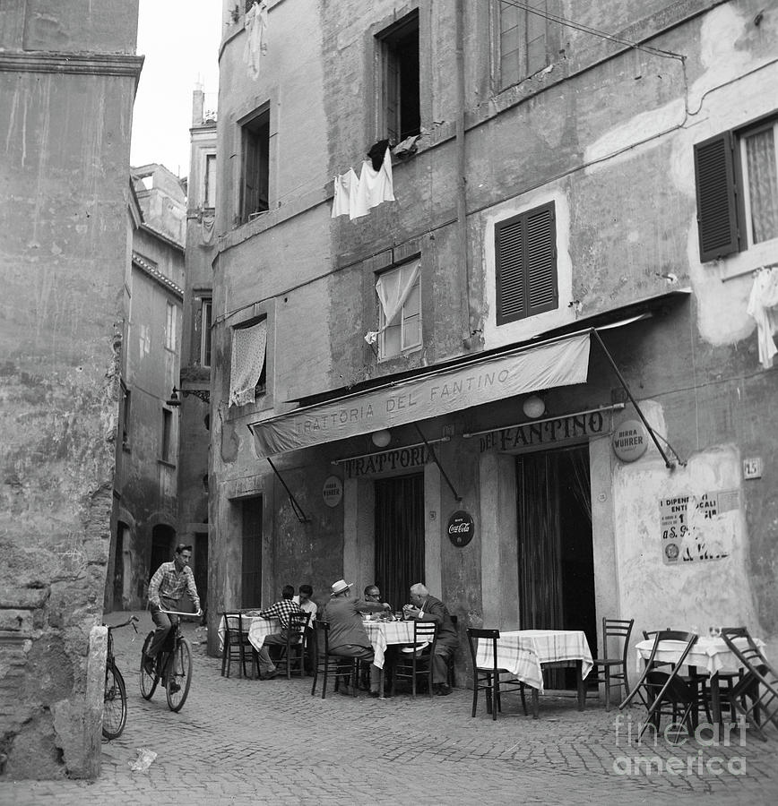 Rome Photograph - Boy on a bicycle on a street in Rome, 1955 by The Harrington Collection