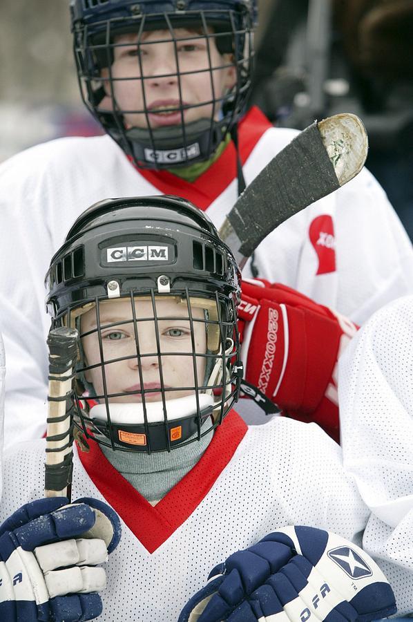 Human Photograph - Boys Playing Ice Hockey by Ria Novosti