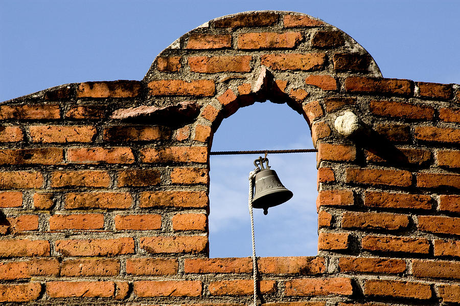 Brick Wall And Bell Photograph by Xavier Cardell