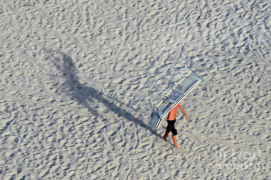 Beach Photograph - Bringing In The Chairs by Craig McCausland