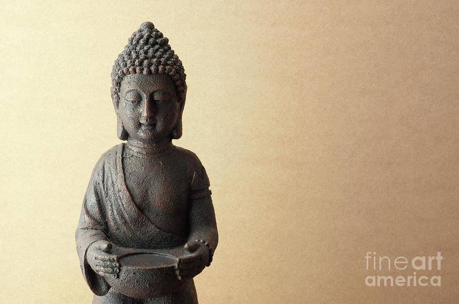 Buddha Statue On Beige Background Photograph