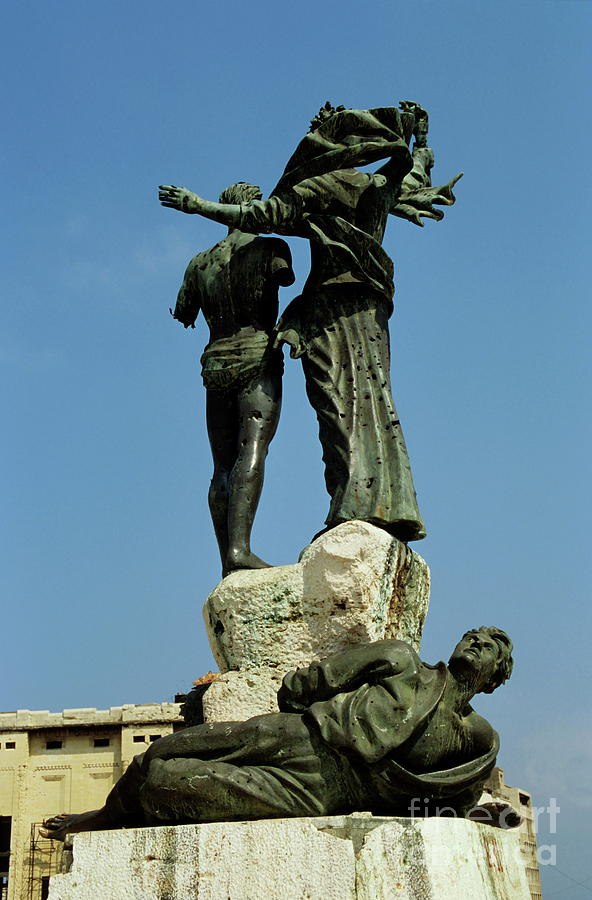 Adverse Photograph - Bullet Holes Covering Statues In Martyrs Place In Beirut by Sami Sarkis