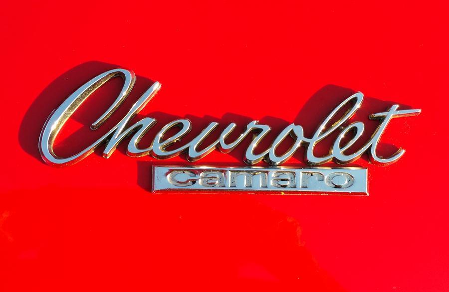 Classic Cars Photograph - Camaro Logo On Cherry Red Car by Linda McAlpine