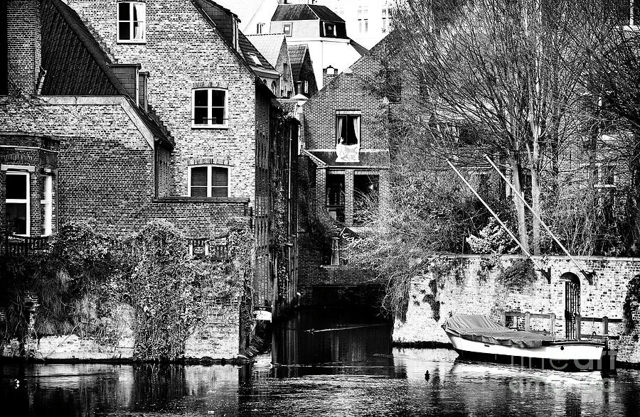Canal Living In Bruges Photograph - Canal Living In Bruges by John Rizzuto
